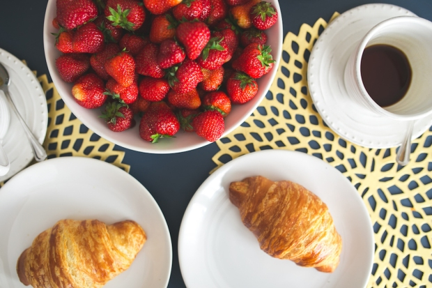 kaboompics.com_Fresh buttery croissants, hot cup of coffee and bowl with strawberries